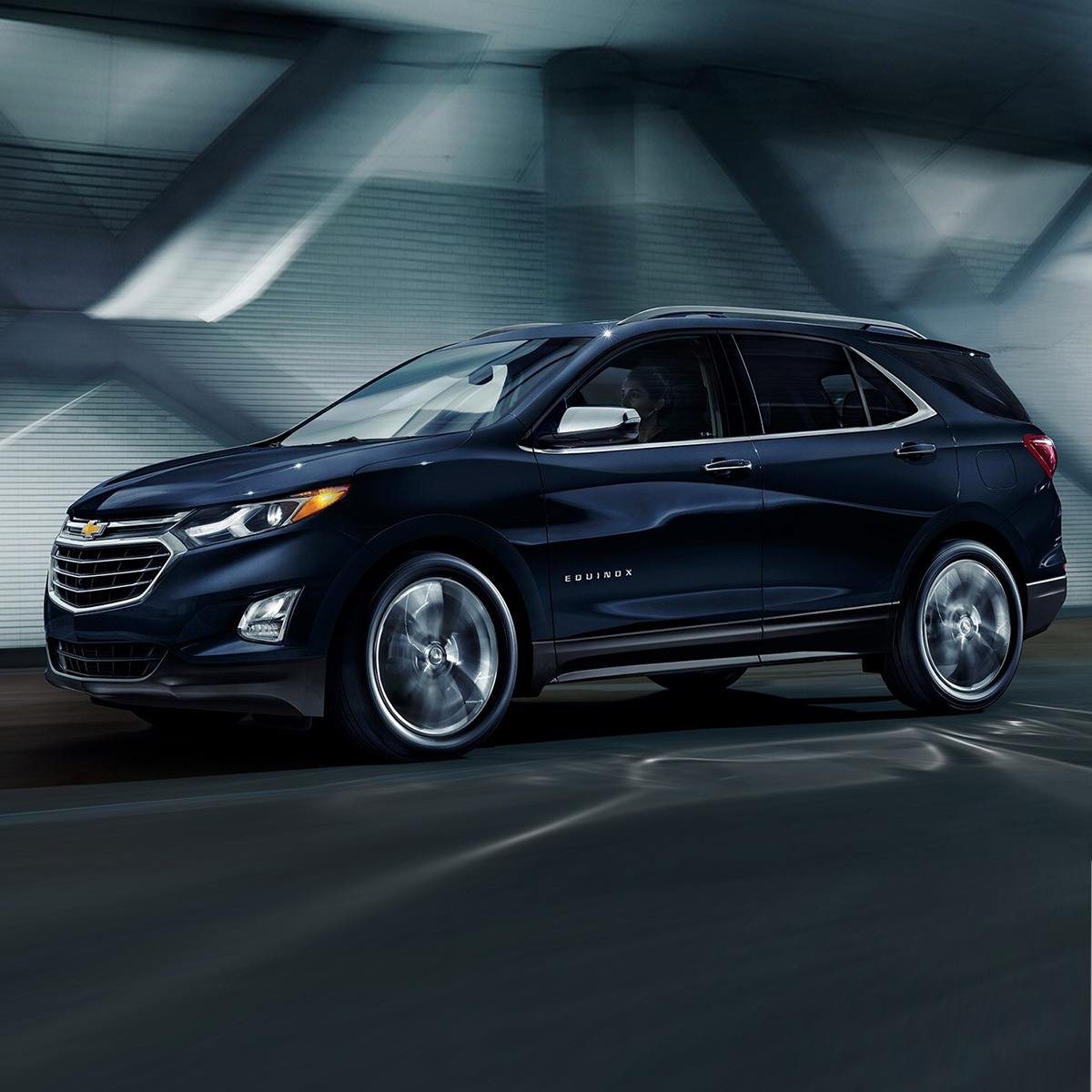 side profile of dark blue chevrolet equinox suv accelerating on the road