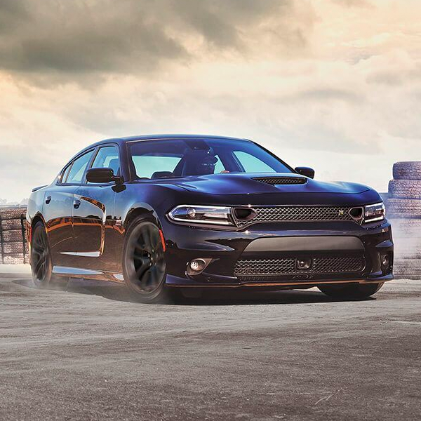 dodge Charger taking a curve on a race track