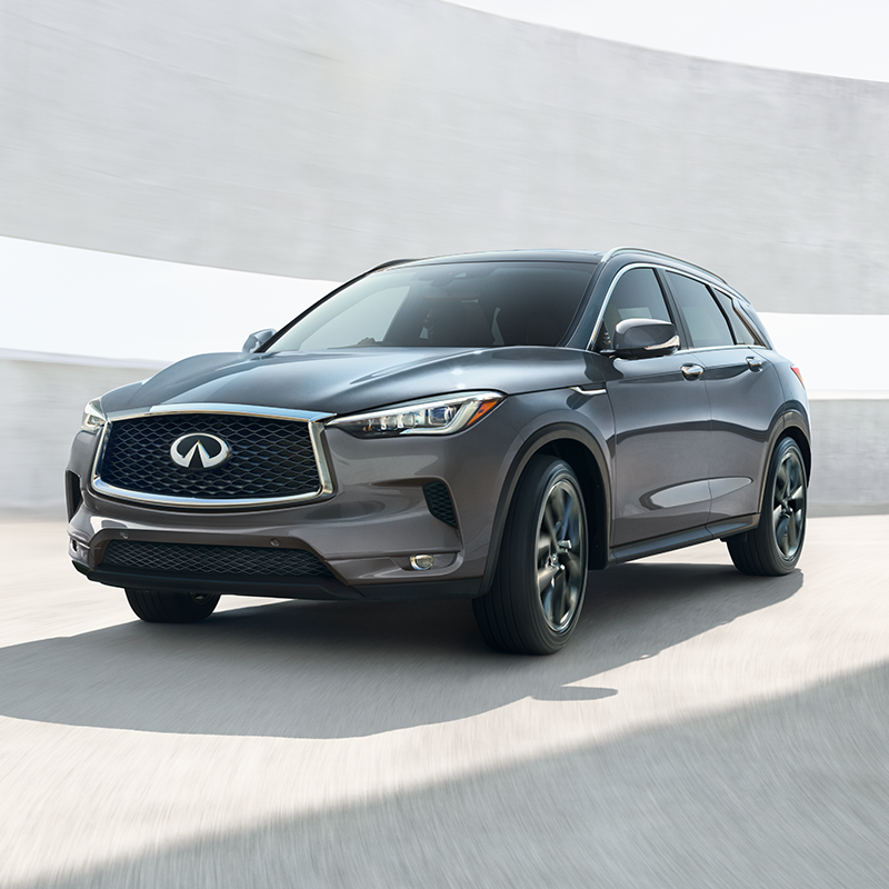 grey INFINITI QX50 suv coming out of a parking lot building