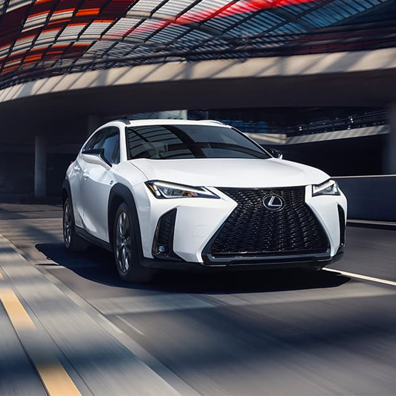white Lexus UX crossover inside a tunnel going at high speed