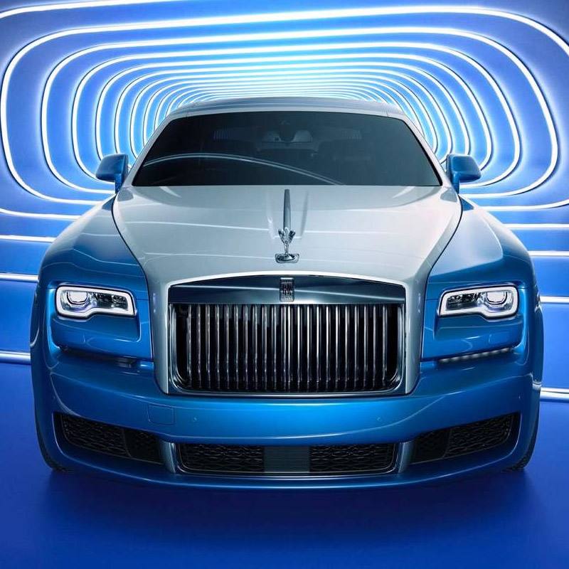 blue Rolls-Royce ghost on a blue studio background