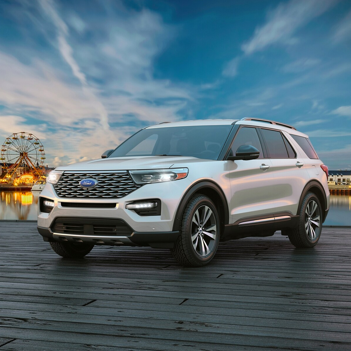 Silver 2021 Ford Explorer parked on a pier with a ferris wheel in the background