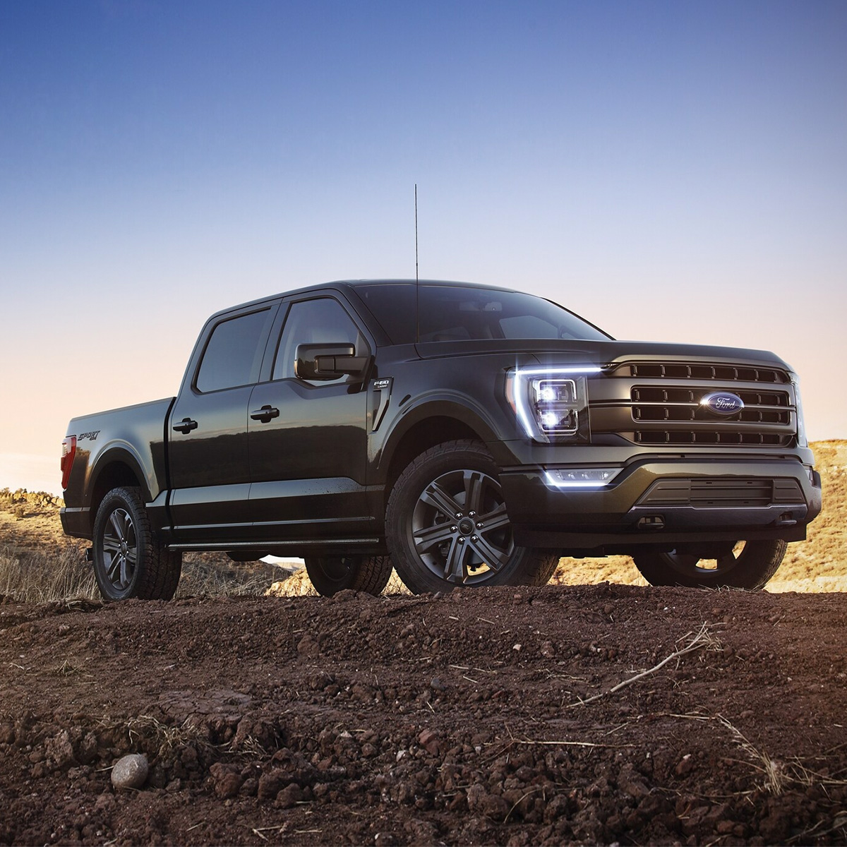 Black 2021 Ford F-150 parked on a dirt near a construction zone